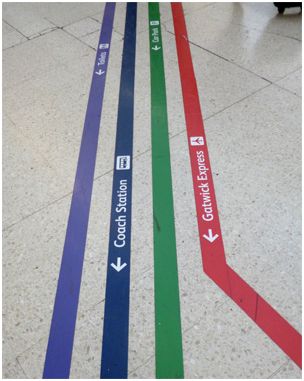 wayfinding floor signs at an airport