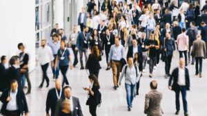 people walking in a hallway attending a corporate training event
