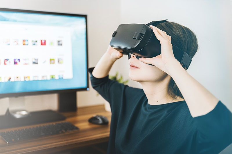 technology in the workplace: a woman using virtual reality in the workplace