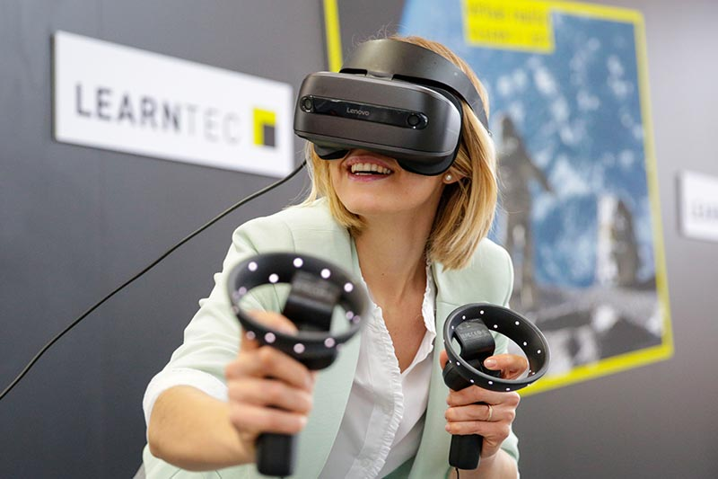 woman using AR glasses at learntec 2019