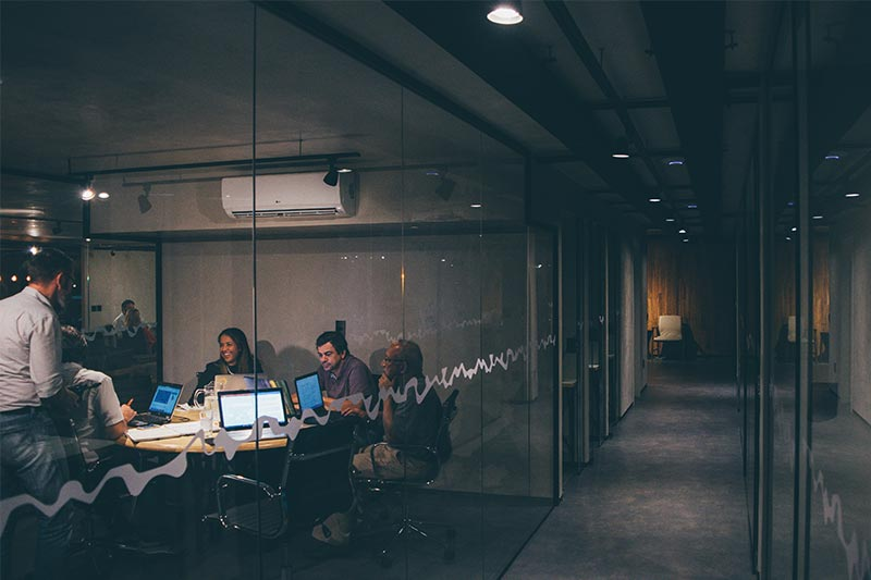 people working in a modern shared office space