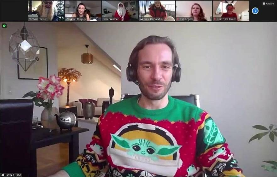 Userlane CEO and co-founder Hartmut Hahn in a Zoom call for Userlane's Christmas party wearing a Christmas sweater with Baby Yoda on the front.