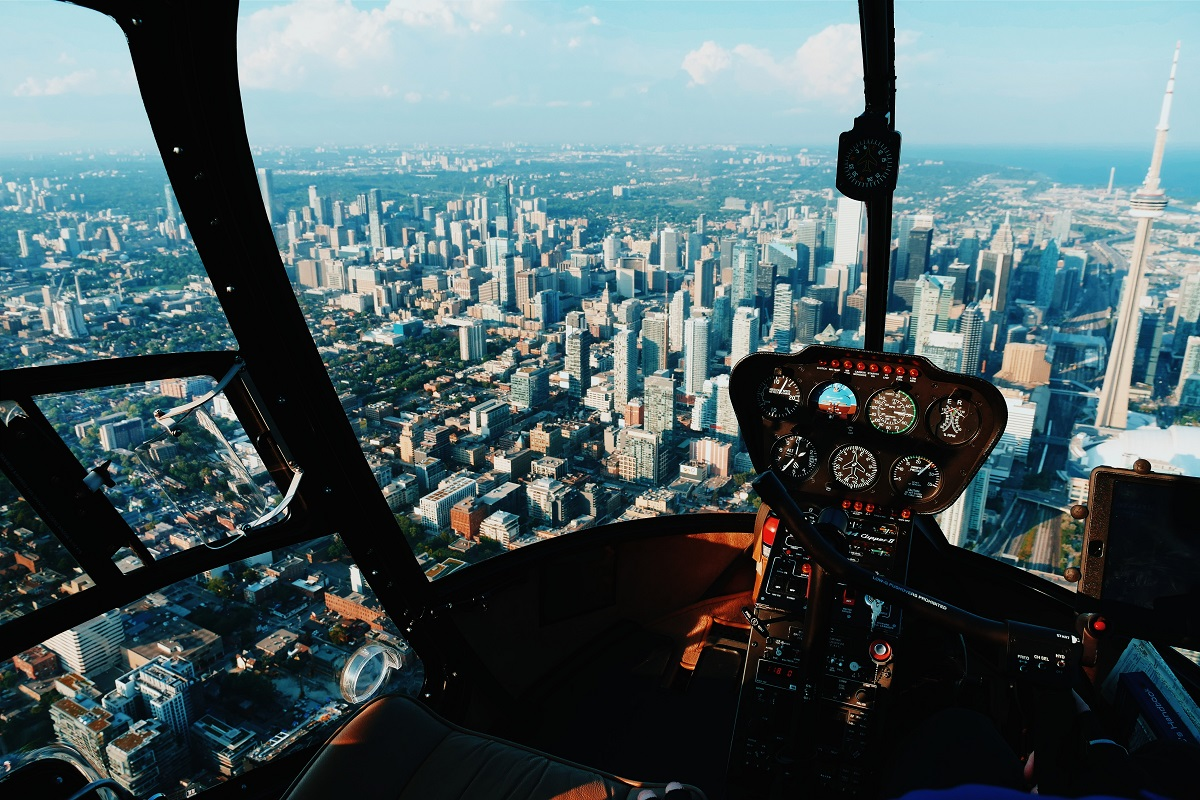 city view from the cockpit of an airplane