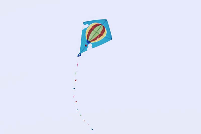 a blue kite in the sky