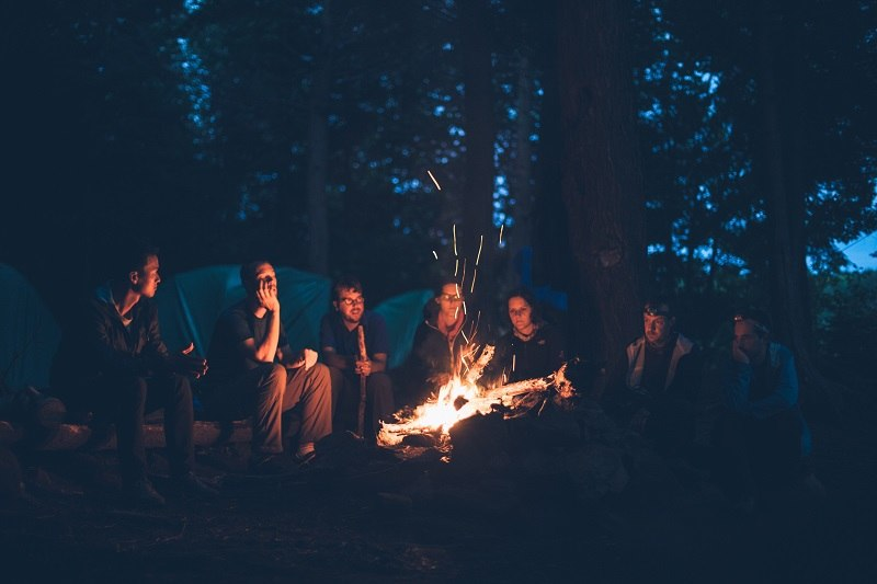 group of friends at a campfire