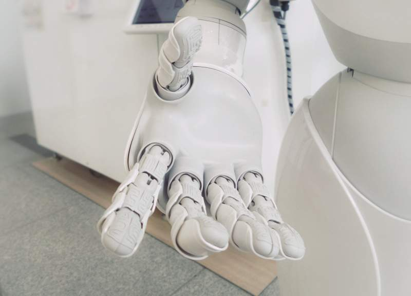 hand of robot demonstrating AI and innovation