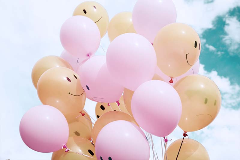 colored balloons with happy customers' faces