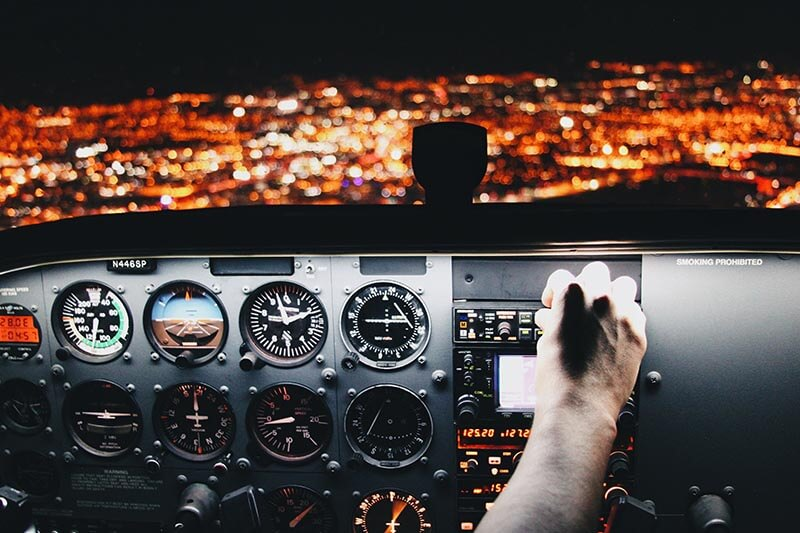 night view of city from the cockpit of a plane