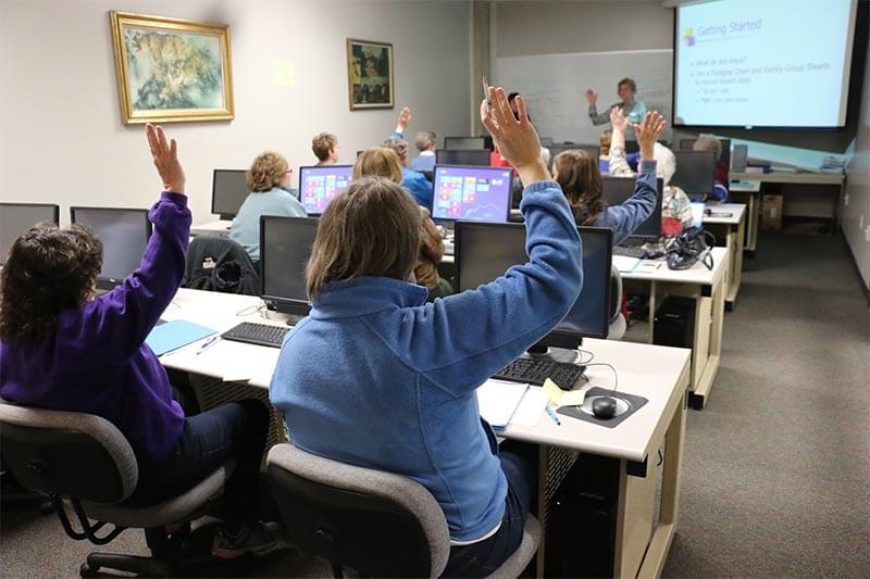 people in a software training room