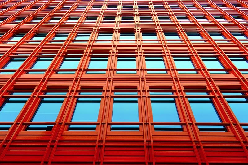 a red building with blue glass panes