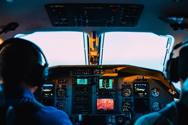 cockpit of an airplane and pilot
