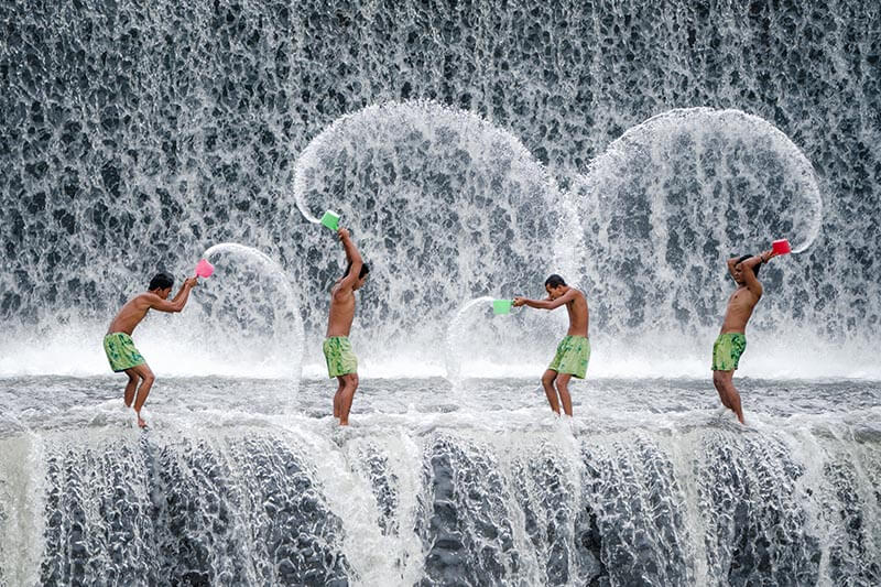 group of men playing with water