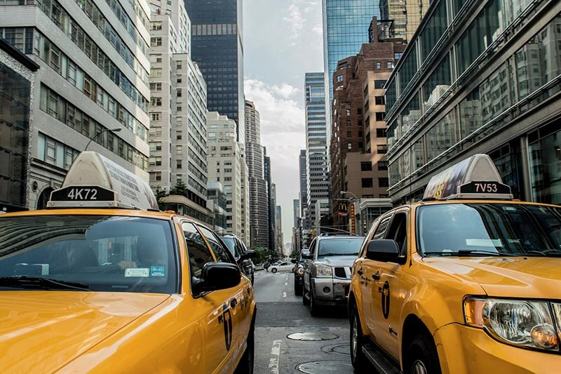yellow taxis on city street
