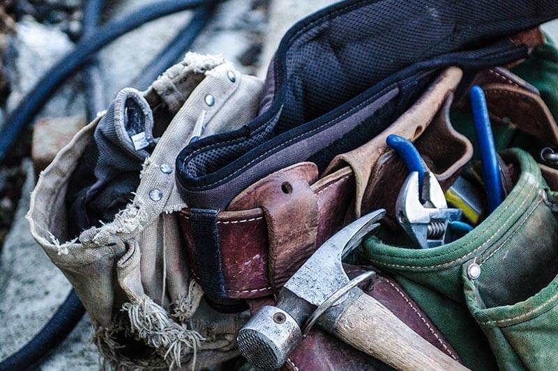 hammer and tools in a leather tool-belt