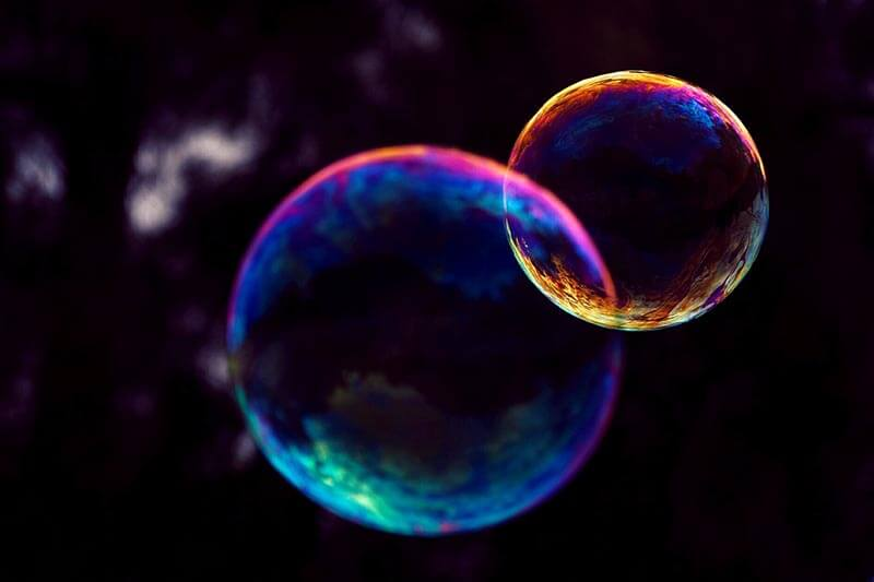 two soap bubbles in a dark background