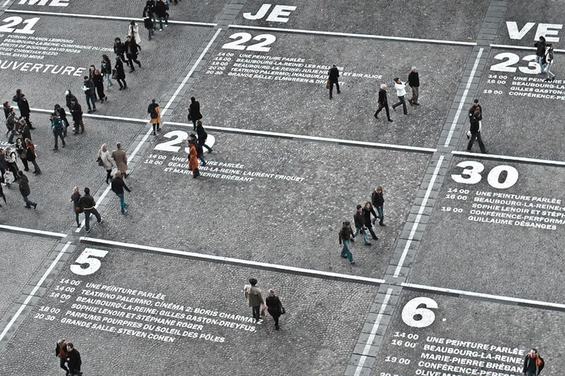 people walking at a city square
