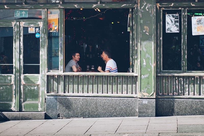 two happy customers talking in an old coffee shop
