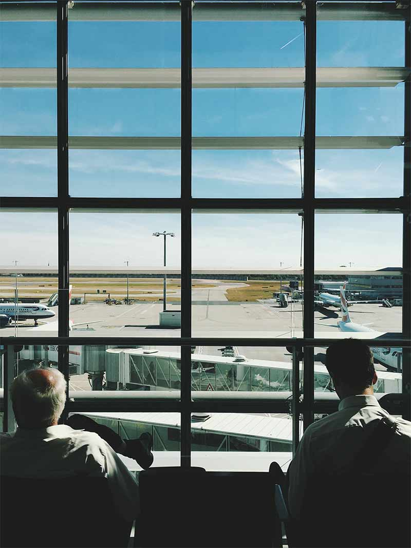 view of parked planes from the airport passenger's lounge