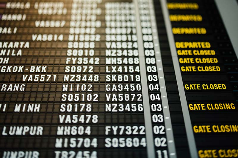 arrival and departure lookup board at the airport