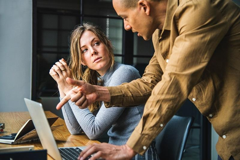 man and woman working together in conference room